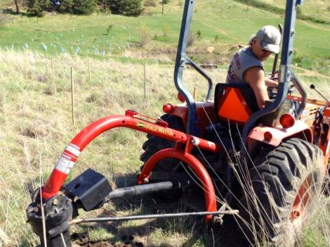 Posthole digging with tractor