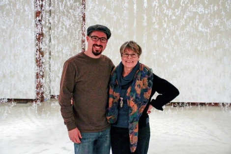 the artists Andy Behrle and Gerri Sayler standing next to each other at opening reception fort hot glue installation entitled Numinous