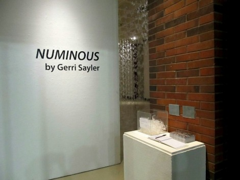 entrance view of hot glue installation titled Numinous by Gerri Sayler