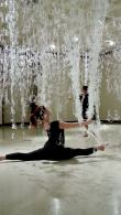 University student dancing in performance with backdrop of Numinous hot glue installation by Gerri Sayler at Spurgeon Art Gallery