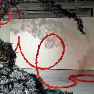 red satin and black mesh of Terra Ignis art installation by Gerri Sayler at Nicolaysen Art Museum