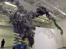 black mesh and lift during installation of Terra Ignis at the Nicolaysen Art Museum