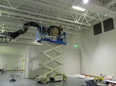 wide view of Artist Gerri Sayler working on Terra Ignis art installation at the Nicolaysen Art Museum
