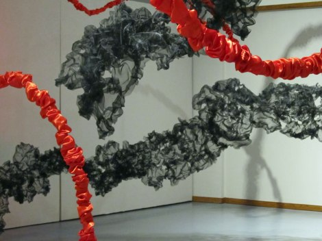 black mesh and detail of swirling red lines of Terra Ignis art installation by Gerri Sayler at the Nicolaysen Art Mueum
