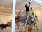 Artist Gerri Sayler working on current art installation at Nicolaysen Art Museum